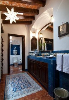 Charming #Spanish style bathroom with beautiful tiles for the floor, backsplash and counter top!