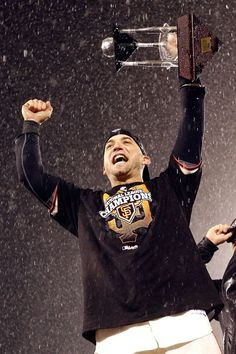 Marco Scutaro #19 of the San Francisco Giants holds up the MVP trophy after the Giants defeat the St. Louis Cardinals 9-0 in Game Seven of the National League Championship Series at AT Park on October 22, 2012