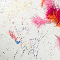 Photo by Heather Patterson Moore - Kids, art, artwork, creative, messy, colored pencils, glitter, sparkles, rainbow, heart, garland, love