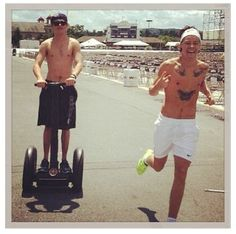 Harry running and Niall on a segway