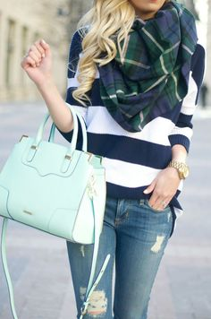 wide striped sweater, plaid scarf, jeans, mint purse