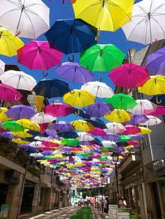 Colorful floating umbrellas, part of the Agueda Festival in Portugal #portugaltravel