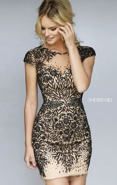 Party in style as you dance the night out in Sherri Hill 1957. This cocktail dress showcases a high scoop neckline of sheer fabric extending through the back that creates a small keyhole detail at the center. Contrasting vine-like embellishments heavily adorn the sheer fabric, perfectly hugging the entire outfit over nude lining.