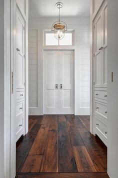 Beautiful barn wood floors illuminated by an Urban Electric Dover bell light while walls lined with inset, built in white shaker cabinets fitted with polished nickel knobs lead to white bi-fold doors positioned under a small transom window flanked by whit Fresh Farmhouse, Modern Farmhouse, White Farmhouse, Modern Country, Farmhouse Trim, Style At Home, Built In Cabinets, Shaker Cabinets, My New Room