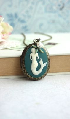 Mermaid Locket Necklace. Best Friends Gifts. Large Oval Brass Locket, Freshwater Pearl, Starfish. Mermaids Locket. Teal Green, By Marolsha by Marolsha - https://www.etsy.com/listing/190080747/mermaid-locket-necklace-best-friends?ref=shop_home_active_5
