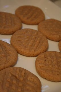 World's EASIEST peanut butter cookies.Preheat the oven to 325 degrees.  Mix 1 egg, 1 cup of peanut butter, & 1 cup of sugar. Just mix it all up with a spoon.  Roll into balls and do the criss-crossy thing with a fork. Bake for 12 minutes.  http://www.sowonderfulsomarvelous.com/2008/10/challenge-29-gifts-day-2.html#