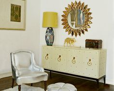 Johnathan Adler- antique chair and vintage ottoman from Youngblood, vintage mirror from Neo Studio,vintage Tommy Parzinger cabinet from Todd Merrill Antiques