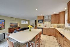 Open up the kitchen and integrate a seating area in place of sun room - ours would have more windows//Mid-Century Modern Masterpiece in Prospect Park...