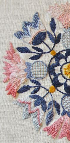 swedish embroidery: Blekingesöm  in light colours, pink light and dark blue