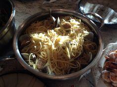 Linguine and clam sauce. 4 dozen littlenecks (2 dozen diced, 2 dozen in the shell).  Garlic, white wine, fresh oregano, sea salt, broth from the steamed clams.