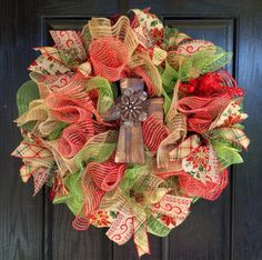 This is a beautiful Christmas deco mesh wreath, with a wooden cross in the center. Made with moss green, red with burlap, and burlap mesh.