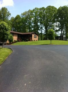I've been thinking about getting my driveway paved again. We have a long driveway like this, and it's starting to crack a lot. I was thinking of getting something different, but I like how smooth this looks.