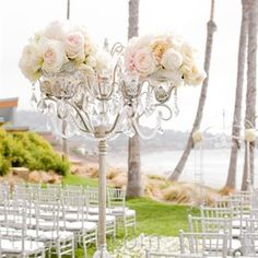 Tall candelabras topped with lush roses and strung with crystals welcomed guests to the ceremony space.