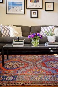 I want to create the effect of this rug with throw pillows on white couches and a neutral rug, with rustic wood furniture ahhh