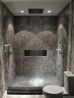 The spa bathroom, me and Ryan need this he could actually fit under the shower head!!