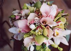 Pink and green bouquet... yes please!  Pale pink mini calla lilies, white and green orchids, wax, and seashells. Mini calla lilies for boutonnieres.