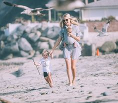Barefoot Blonde Amber wearing Solly Baby in Heather Grey