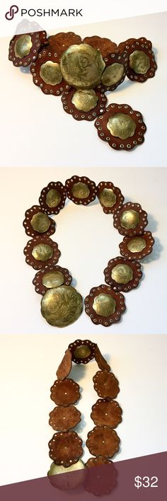 Moroccan Leather and Brass Circle Concho Boho Belt Vintage quality, both the leather and the brass have developed a patina only years can create.  They make synthetic versions of this style of belt now, but this is the genuine article. Rich brown leather with golden brass medallions and grommets. The brass tarnished and transferred beneath each concho, not distracting but want it to be known. Length: 40 inches, buckle can be hooked into any of the grommets incorporated in the design. Boho…