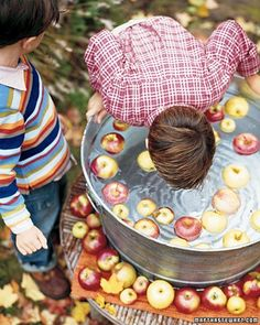 """The classic game of bobbing for apples in a tub of water began as a way to predict a player's fortune. In one version of the game, anyone who got an apple would marry. In another, a dime was put in one apple, a ring in a second, and a button in a third, predicting fortune, marriage, and """"single blessedness,"""" respectively. Today's kids may balk at such a quaint ambition, but even without mention of marriage, the game's bobbing, splashing, and general hilarity provide plenty of entertainment…"""
