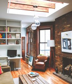 Gorgeous high ceilings, exposed brick and skylight. Loving this charming Chelsea apartment.