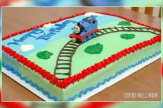 Sodor Sheet Cake This super-easy dessert starts with a sheet cake. Pipe on some icing tracks, add your kid's favorite train, and you're done! #thomasandfriends #thomasbirthday #birthdaycakes #thomasthetrain