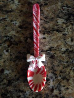 Candy cane spoons used Wilton spoon mold and Martha Stewart mold for bow HOW GREAT WOULD THIS BE IN HOT CHOCOLATE ??????