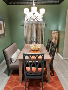 This Olive Green Dining Room Is Accented With Burnt Orange Accessories That Bring Life To The