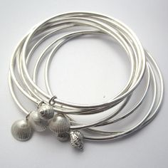 Shell bangles, with shells from a Dorset beach cast in solid silver. www.CharlotteBezzant.com