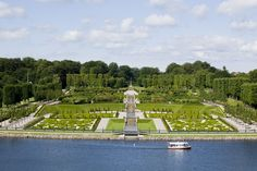"The baroque garden and the small tour boat ""Frederiksborg"", famous for sailing the most beautiful mile in Denmark"
