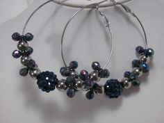 """Basketball wives inspired hoop earrings in blue and silver beads. Large hoops measure 2-1/2"""".  $2.00  Available at www.blingychics.com"""