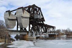 Train Bridges, Railway Bridges and Trestles, Ontario and Quebec --- CNR Kaministiquia Bascule Lift Bridge - Strauss  Thunder Bay, ON It is a trunion bascule bridge  built in 1911  This bridge is listed on the Ontario Heritage Bridge list.--- Canada