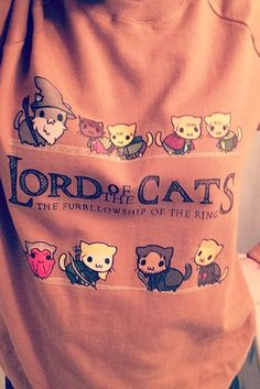 """Redbubble has your new go-to funny tee. We can't get over this """"Lord of the Cats"""" parody—it combines two of our favorite things!"""