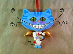 I've wanted a Cheshire Cat tattoo for years - in this style, not disney..... yes, I have a plan!