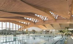 which it continuously strives to enhance by developing new ranges of products and construction systems. Timber Architecture, Timber Buildings, Architecture Details, Airport Design, Timber Panelling, Timber Structure, Building Systems, Roof Design, Wood Laminate