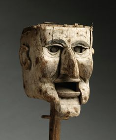 "This powerful naive sculpture has a simple hand operated mechanism to raise and lower the eyes and mouth, Patinated, Carved and Painted Wood and Metal, English, c.1870, 14.50"" high."