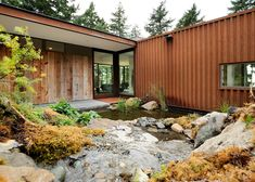 Eagle Ridge Residence by Gary Gladwish frames a rockery and pond | Rusty corrugated steel and wood salvaged from an old barn clad the exterior of this L-shaped house designed by American architect Gary Gladwish on Orcas Island, Washington | (A personal favorite)