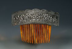 Chinese horn comb, silver heading