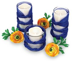 Supplies FloraCraft® Brand Products:Design It:® SimpleStyle®:∙ Decorative Mesh, 6″ wide: 5 3/4 yd., Cobalt Blue∙ Floral Shears Clear glass vases: Two 3 3/4″ diameter x 7″ tall and one 4 1/2″ diameter x 4 1/2″ tallIvory LED candles: Two 3″ diameter x 6″ tall and one 3″ diameter x 4″ tallOptional: Ranunculus flowers, approx. 3″... Read the Rest