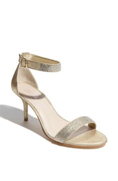 Potential wedding shoe for Kim's day. Low-ish heel, pop of sparkle and a strap to hold you in.