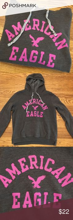 """AEO Sweatshirt Grey sweatshirt with hood and front pocket. Light grey drawstrings for hood. Purple/ pink writing in """"worn out"""" print. Colors are pretty true to pictures. Slim fit, fits a medium slightly loose. American Eagle Outfitters Tops Sweatshirts & Hoodies"""