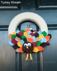 Such a cute Turkey Wreath from Craftaholics Anonymous. Love the colorful felt tail feathers.