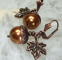 Great use of the acorn bead caps....simple, but something you'd love to wear every day.  Find bead caps like this in all our 7 designer plating shades at bsueboutiques.com  Buy the earrings from the Etsy seller here:  http://www.etsy.com/listing/63654640/maple-leaf-copper-acorn-earrings