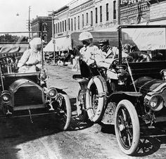 RULES: Two cars stopped on an urban street As this early 20th century image suggests, early automobile users didn't have to follow the same kinds of rules of the road that began to become standard.