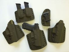 One big happy Kydex family.  Double mag carrier, 1 IWB holster and 3 OWB holsters.  Proudly made at    www.geartofit.com