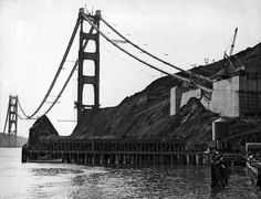 Construction on San Francisco's Golden Gate Bridge began in 1933 and opened in 1937. These photos show the suspension bridge between 1935 and 1937 as it begins to take form.