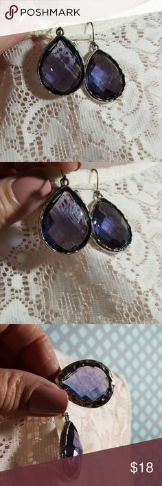 Blue cut crystal earrings faceted set in silver Blue cut crystal earrings faceted set in silver Tear drop shape    Pre owned condition *******All items are in pre owned condition, Nothing, unless noted , is brand new **** please ask questions For sale in my posh closet  LINK IN MY BIO Jewelry Earrings