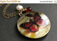 HOLIDAY SALE Fire Butterfly Necklace. Butterfly Locket Necklace with Red Teardrop and Fresh Water Pearl. Handmade Jewellery. by StumblingOnSainthood from Stumbling On Sainthood. Find it now at http://ift.tt/2h4vTbM!