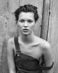 Discovered at the age of 14, Kate Moss ushered in the 'Heroin Chic' look. Photographed here by Peter Lindbergh in 1994.
