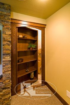 Basement Hidden Storage The bookcase is a secret door that hides storage. ©Finished Basement Company Basement Hidden Storage The bookcase is a secret door that hides storage. Basement House, Basement Apartment, Basement Bedrooms, Basement Bathroom, Basement Flooring, Basement Office, Walkout Basement, Basement Pool, Apartment Ideas