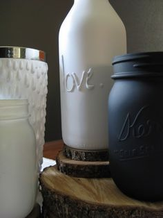 jars labeled with puff paint or hot glue, then spray painted
